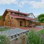 """Holzhaus aus massiven Kantholzbalken """"Bösshenz"""""""