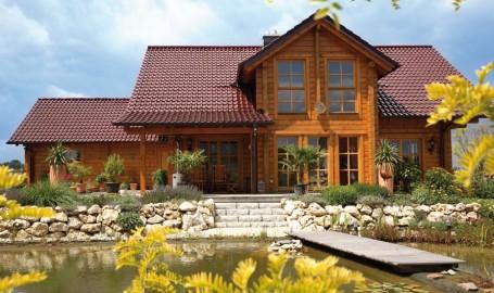 "Holzhaus aus massiven Kantholzbalken ""Buchholz"""