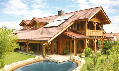 """Holzhaus aus massiven Kanbalken """"Kösslinger"""""""