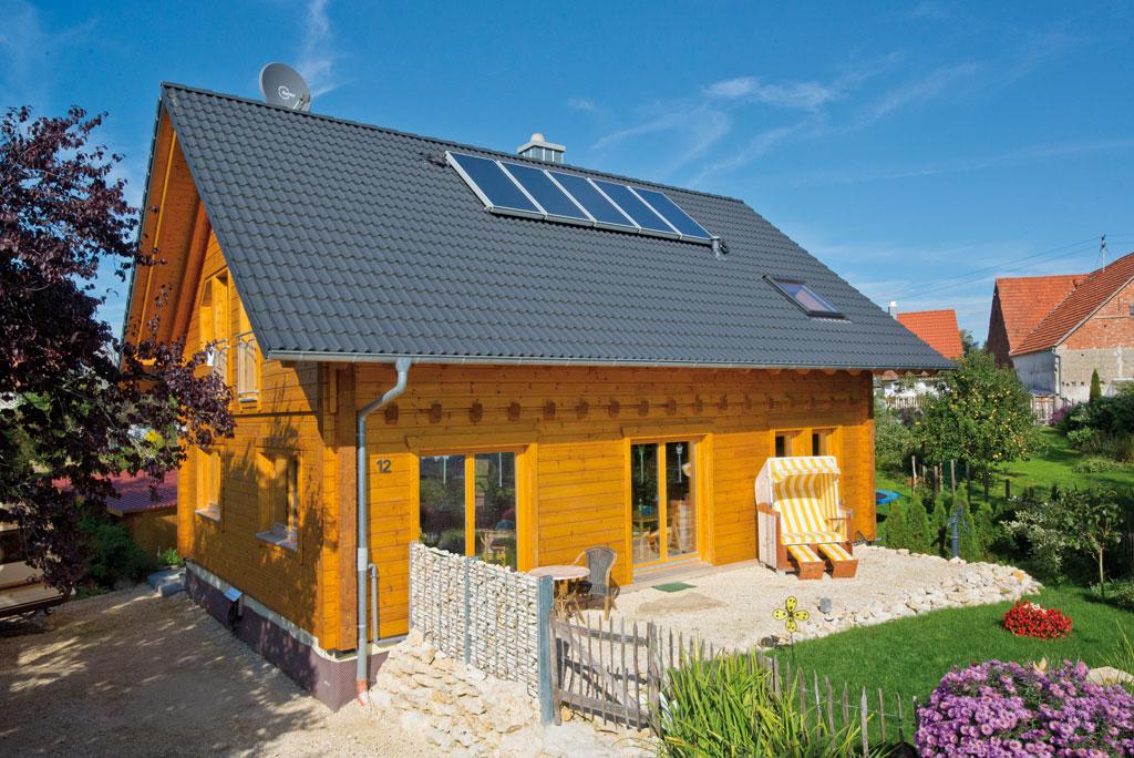 blockhaus kantholzbalken hummel holzhaus hultahaus bauen in bayern baden w rttemberg. Black Bedroom Furniture Sets. Home Design Ideas