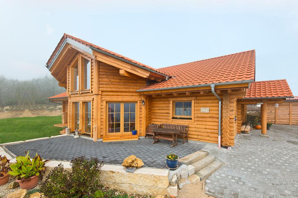 blockhaus rundbalken gubo holzhaus hultahaus bauen in bayern baden w rttemberg. Black Bedroom Furniture Sets. Home Design Ideas